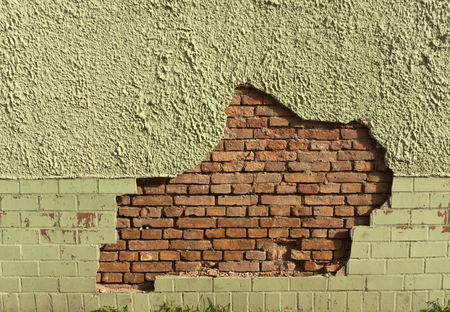 damaged: Damaged wall. Architrectural background and texture.