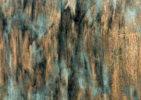 pitting: Rusty metal wall syrface with paint strockes. Background and texture for design.