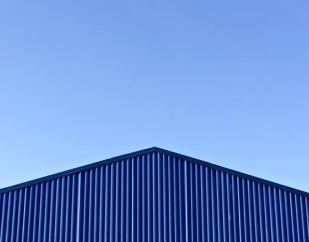 Blue Modern Warehouse Roof Against Blue Sky. Background For Design on warehouse entrance design, warehouse floor design, warehouse interior design, warehouse garage design, warehouse home design, warehouse exterior design, warehouse ceiling design, warehouse office design, warehouse facade design, warehouse kitchen design, warehouse roof design,