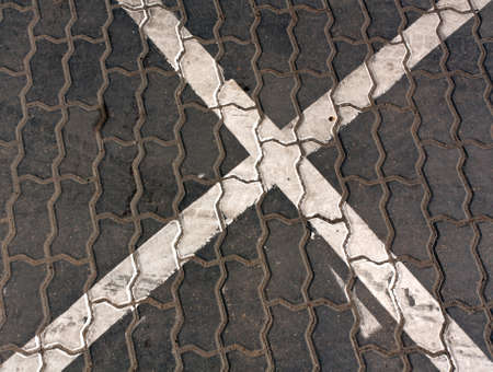 soil texture: White traffic sign on gray pavement. Signs and symbols background.