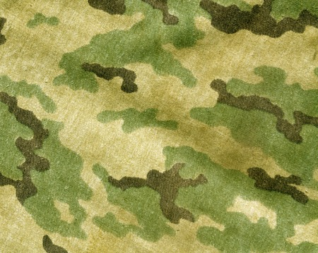 Abstract old camouflage cloth texture. Background and texture for design