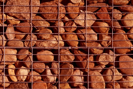 gabion mesh: Pile of stone with metal grid. Abstract background and texture for design.