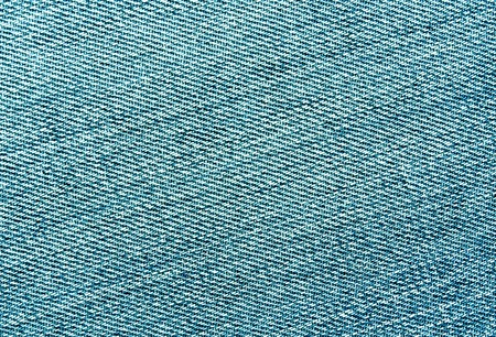Close-up of cyan color jeans cloth. abstract background and textures for desgn.