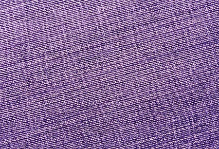 Close-up of purple jeans cloth. abstract background and textures for desgn.