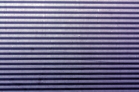 purple metal: Corrugated purple metal plate surface. Abstract background and texture for design.