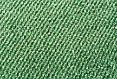 Close-up of green jeans cloth. abstract background and textures for desgn. Stock Photo
