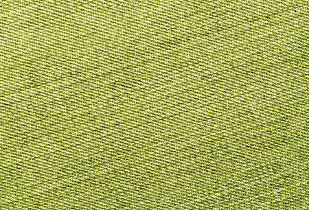 Close-up of yellow jeans cloth. abstract background and textures for desgn.