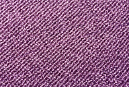 Close-up of pink jeans cloth. abstract background and textures for desgn.