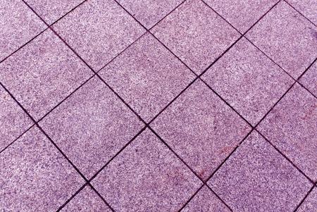 Magenta toned pavement texture. Background and texture. Reklamní fotografie