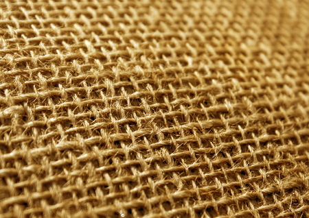 Ornage color hessian cloth sack texture with blur effect. Abstract background and texture for design.