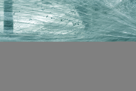 polythene film: Cyan color plastic wrap surface. Abstract background and texture for design Stock Photo