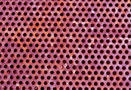 grille: Pink color perforated metal floor pattern. Abstract background and texture for design. Stock Photo
