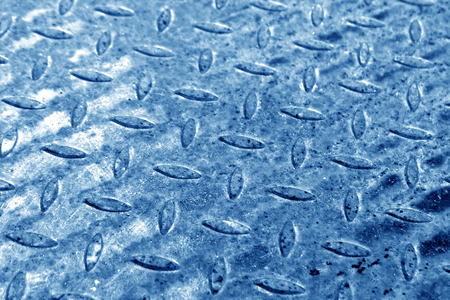 Close-up of blue metal floor pattern with blur effect. abstract background and texture for design. Stock Photo