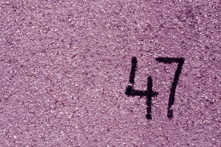 number fourty seven on purple plaster wall. abstract background. Stok Fotoğraf