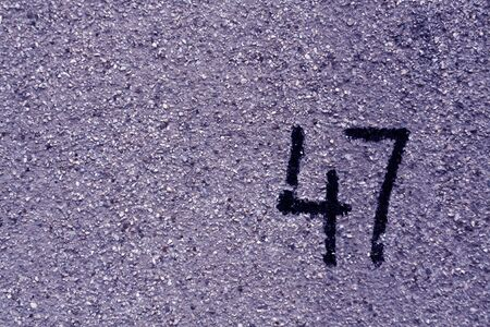 number fourty seven on blue plaster wall. abstract background. Stok Fotoğraf