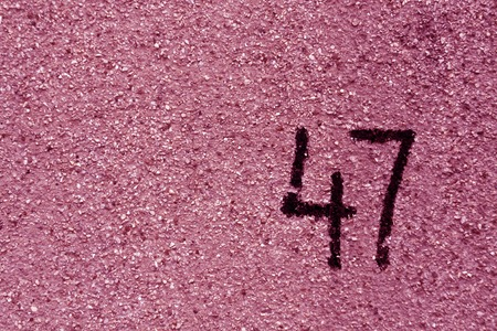 number fourty seven on pink plaster wall. abstract background. Stok Fotoğraf