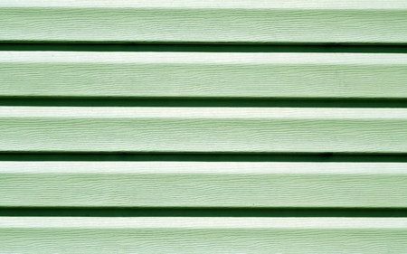 Green color plastic panel wall pattern. abstract architectural background and texture. Stock Photo