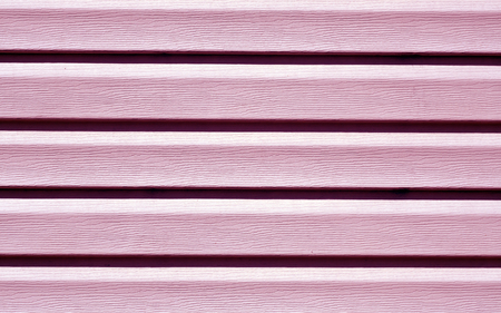 Pink color plastic panel wall pattern. abstract architectural background and texture.