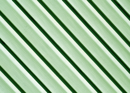 Green color pvc siding wall. Abstract background and texture for design.
