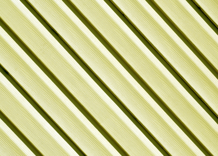 Yellow color pvc siding wall. Abstract background and texture for design.