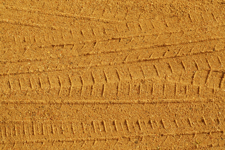 Tyre tracks on sandy road. Abstract background and pattern. Stock Photo