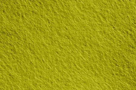 Felt surface in yellow color. Abstract background and texture for design.