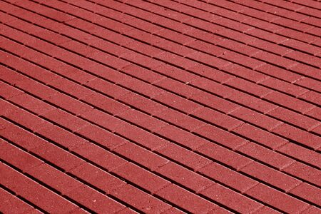 Cobble stone pavement surface pattern in red tone. Background and texture. Stock Photo - 94439734
