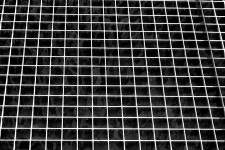 Metal grid texture in black and white. Abstract background and texture for design.
