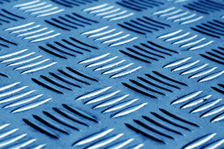 Diamond shaped metal floor pattern with blur effect in navy blue tone. Abstract background and texture for design. Stok Fotoğraf