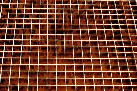 Metal grid texture in orange tone. Abstract background and texture for design.