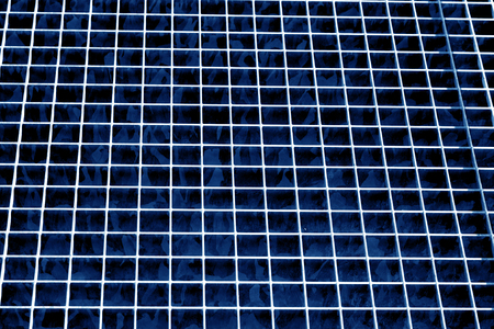 Metal grid texture in navy blue tone. Abstract background and texture for design. Stock Photo