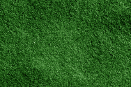 Felt surface in green color. Abstract background and texture for design.