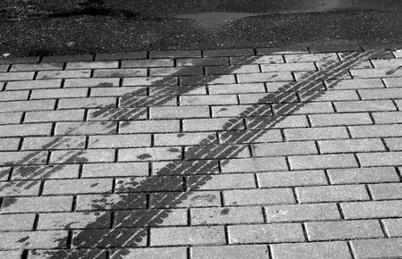 Wet tyres track on pavement in black and white. Abstract background and texture for design