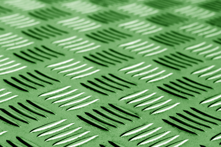 Diamond shaped metal floor pattern with blur in green tone. Abstract background and texture for design. Stok Fotoğraf