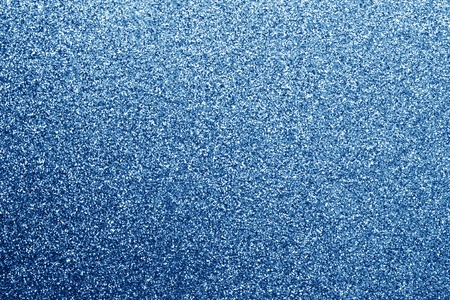 Glittering background in navy blue color. Abstract background and texture for design.