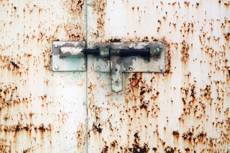 Old padlock on metal gate. Abstract background and texture. Archivio Fotografico