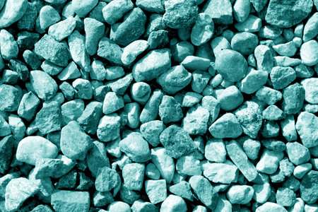 Pile of small gravel stones in cyan tone. Seasonal natural background. Stock Photo