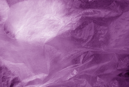 Plastic transparent old wrap texture in purple. Abstract background and texture for design.