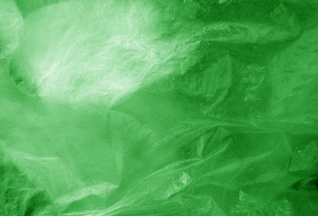 Plastic transparent old wrap texture in green. Abstract background and texture for design.