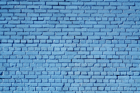 Blue color old grungy brick wall surface. Abstract architectural background and texture for design.