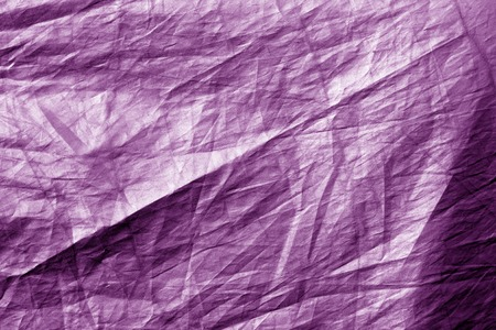 Crumpled plastic textile texture in purple tone. Abstract background and texture for design.