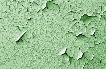 Crack and damage on painted texture in green tone. Abstract background and texture for design. Stock Photo