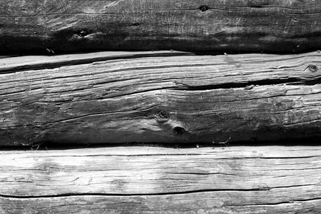 Old wooden wall in black and white. Abstract background and texture for design.
