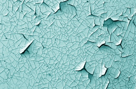 Crack and damage on painted texture in cyan tone. Abstract background and texture for design.