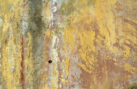Yellow color grungy cement wall texture. Abstract architectural background and texture for design.