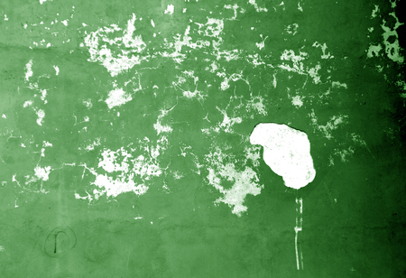 Craked weathered cement wall texture in green tone. Abstract background and texture for design.
