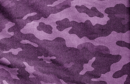 Old camouflage cloth in purple tone. Abstract background and texture for design.