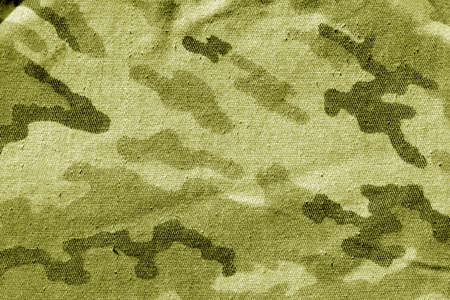 Dirty camouflage cloth in yellow tone. Abstract background and texture for design abd ideas.