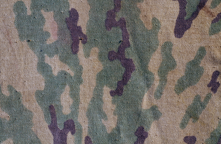 Old camouflage cloth texture. Abstract background and texture for design abd ideas.