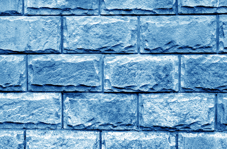 Decorative brick wall in navy blue color. Abstract background and texture for design. Stock Photo